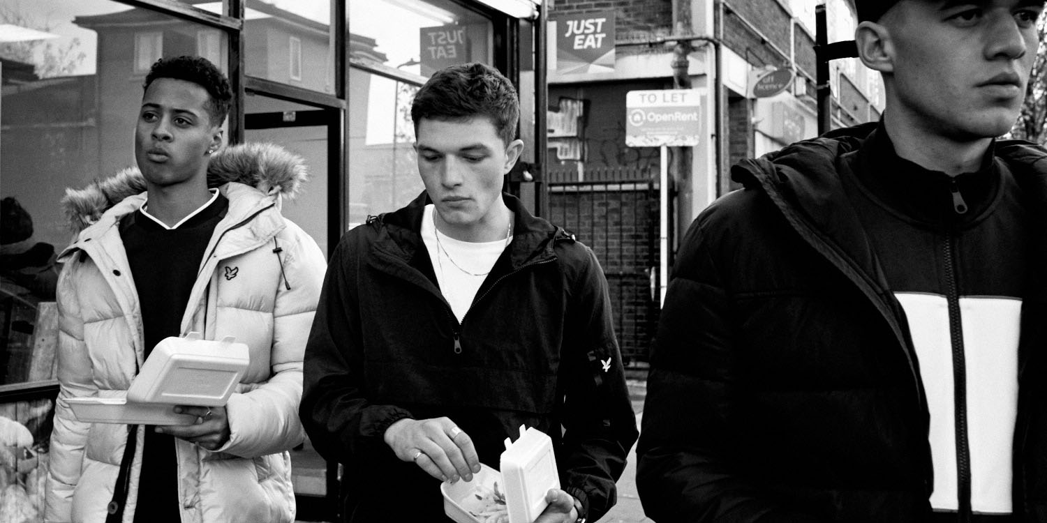B/W, 3 Lads in winter on street by lifestyle photographer