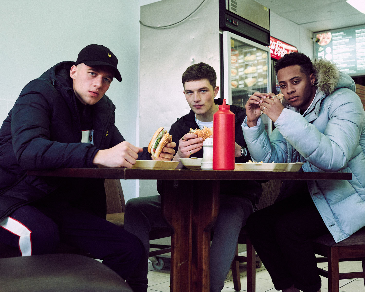 3 Ladst, in kebab shop by lifestyle photographer Tim Cole