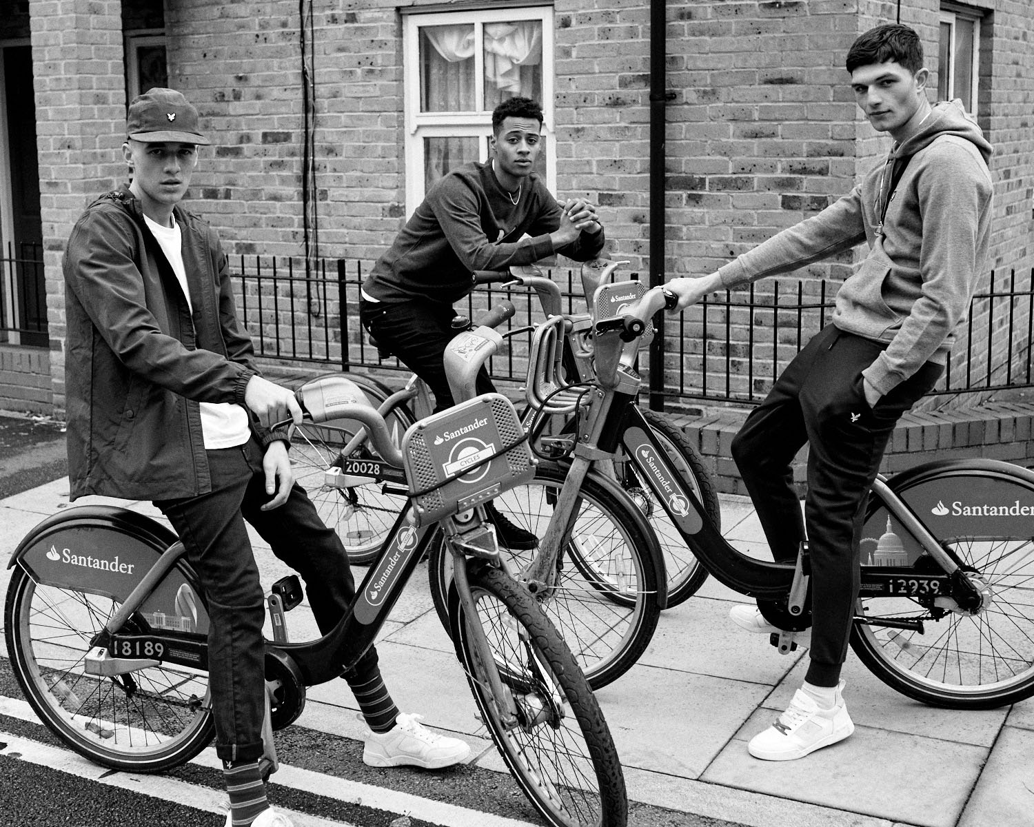 B/W, 3 Lads on Boris bikes by lifestyle photographer Tim Cole