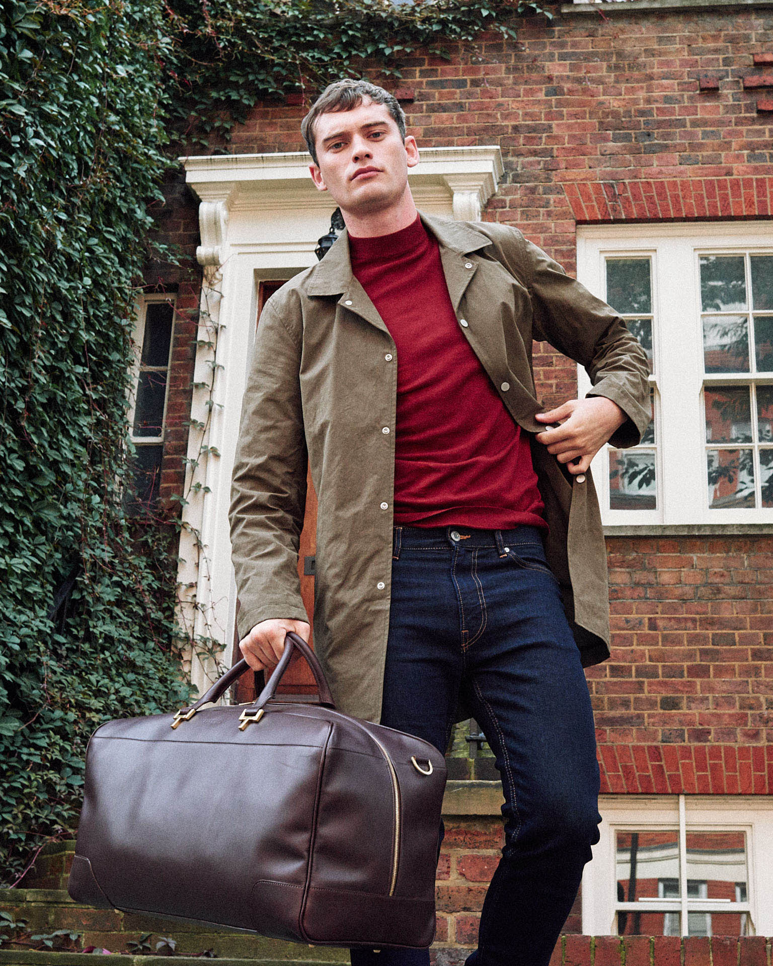 man holds brown leather holdall by lifestyle photographer Tim Cole