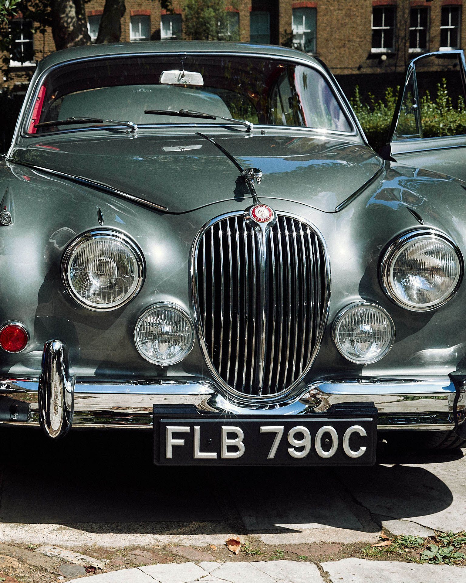 Front grill of a classic  Jaguar by lifestyle photographer Tim Cole