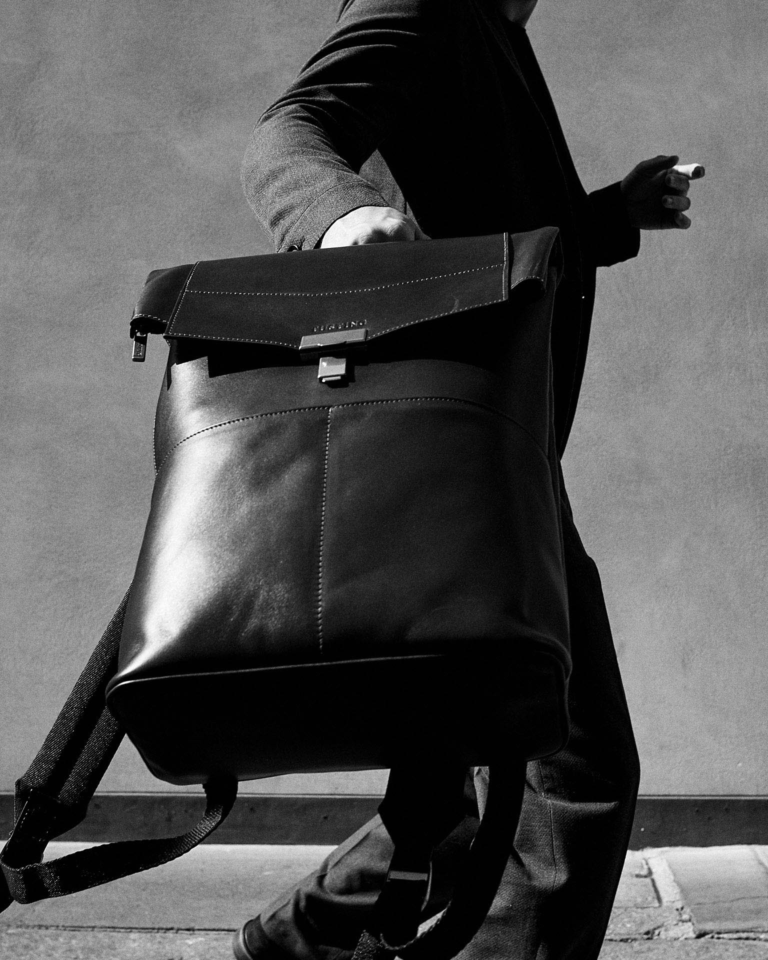 man swings bag by lifestyle photographer Tim Cole