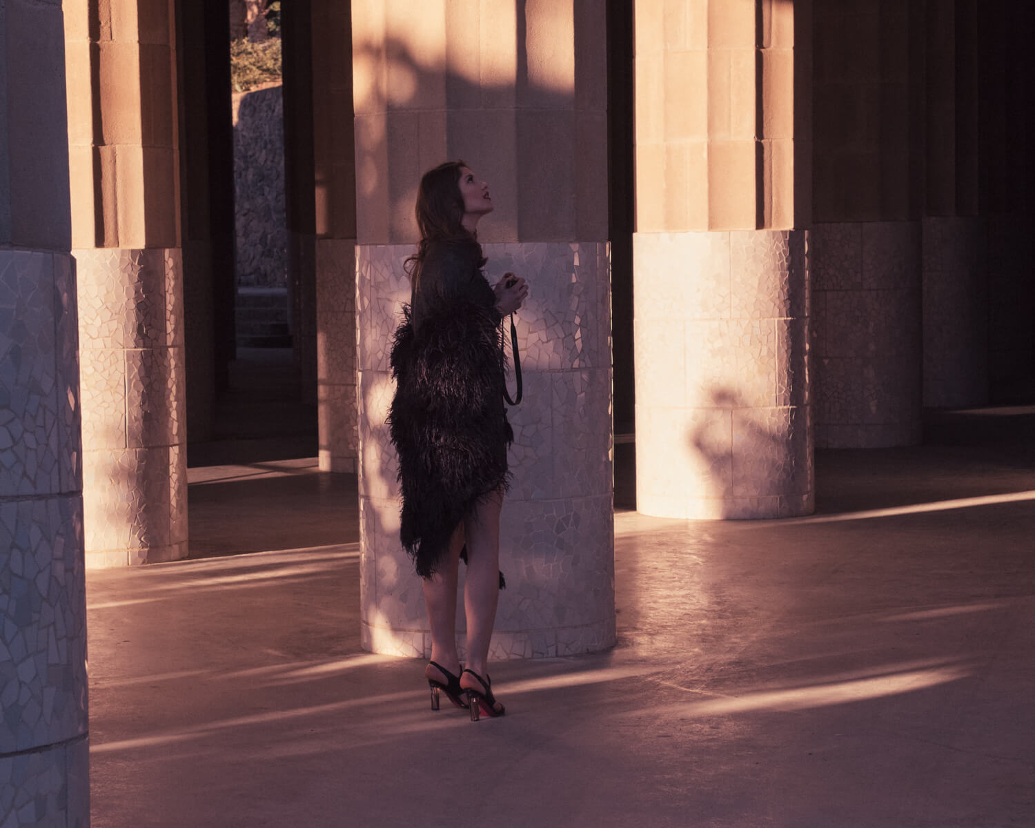 Woman, golden columns by lifestyle photographer Tim Cole