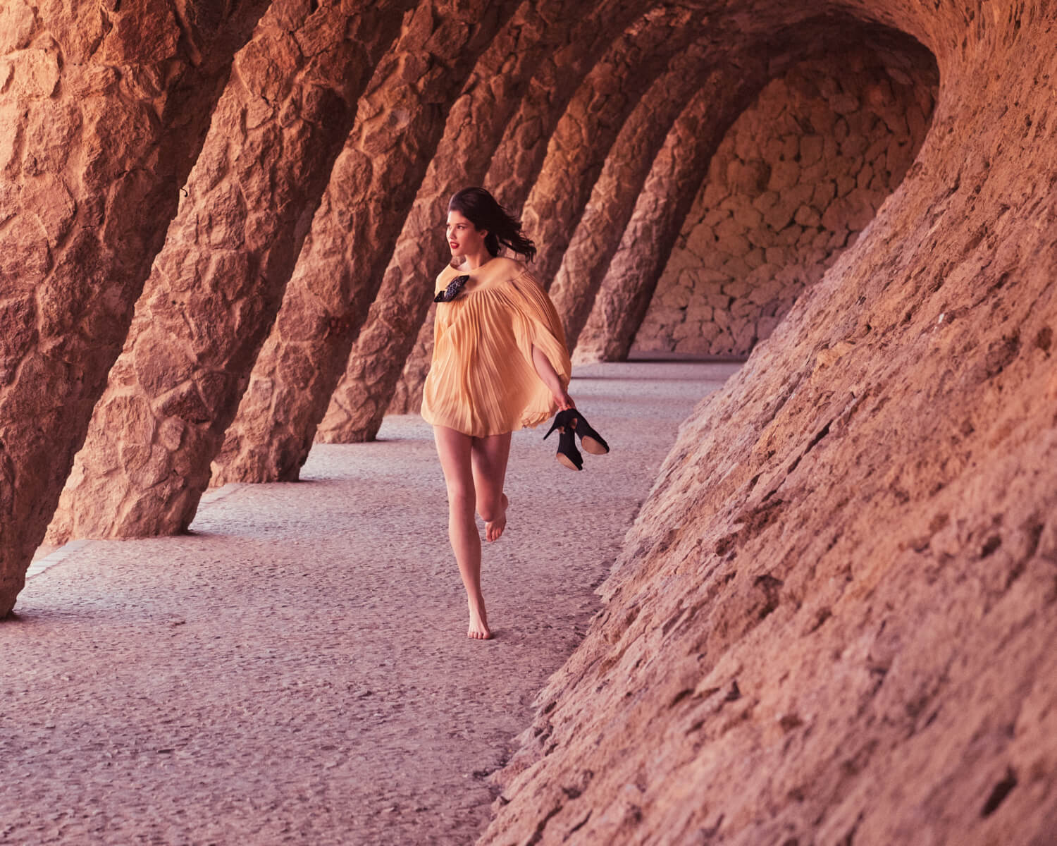 Woman, runs  in Park Güell by lifestyle photographer Tim Cole
