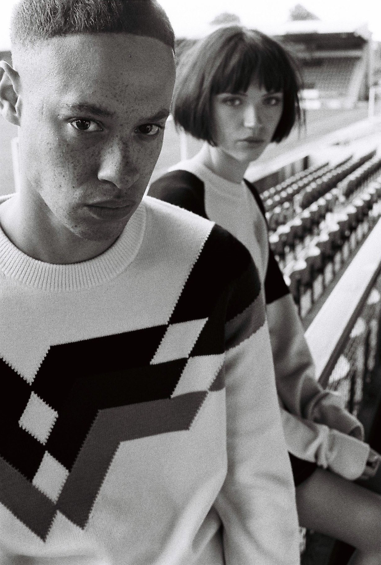 1 Lad, 1 girl in stadium by lifestyle photographer Tim Cole