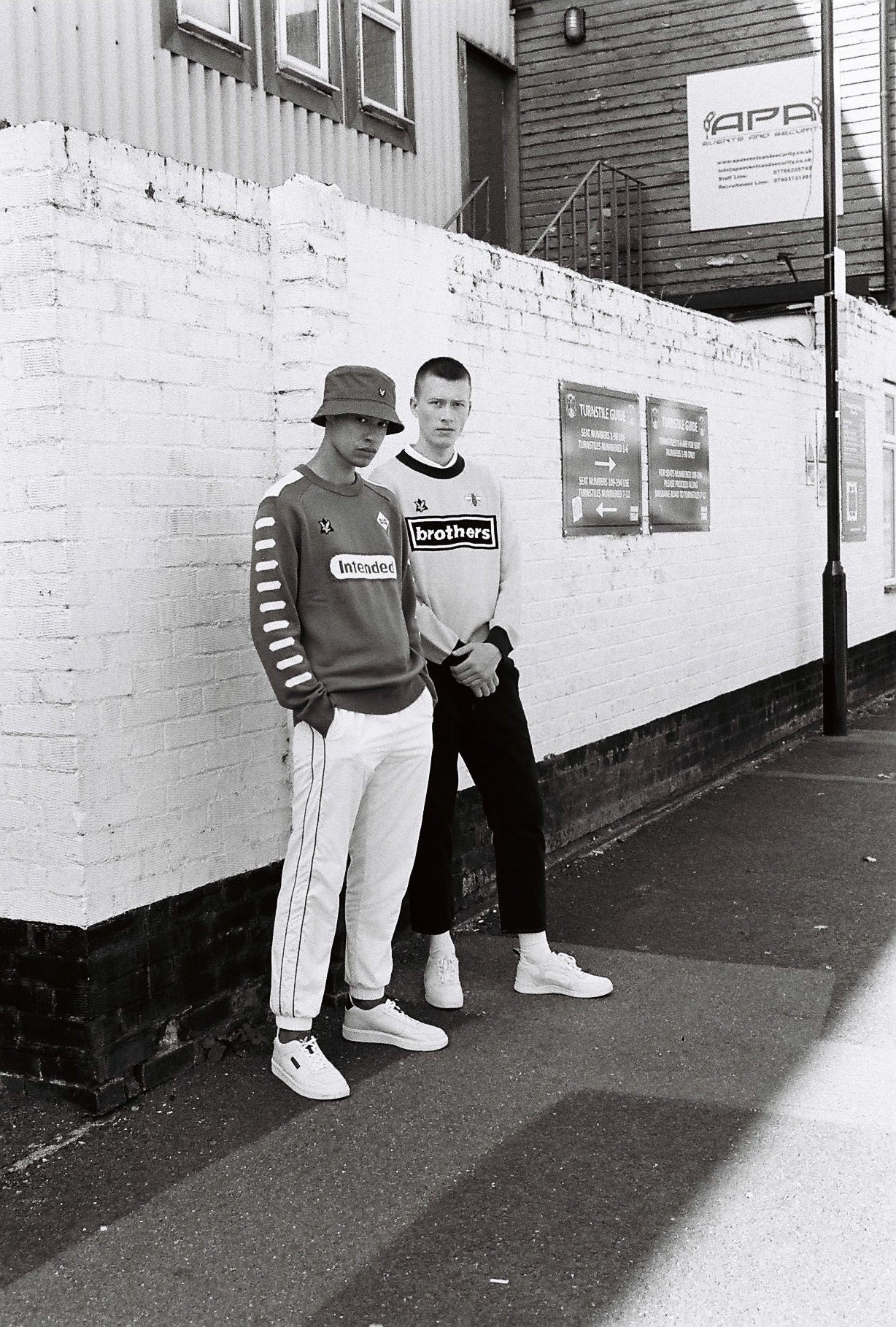 B/W, outside football ground by fashion photographer Tim Cole