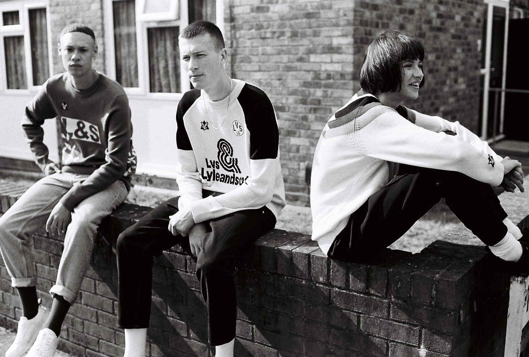 B/W, 2 Lads, 1 girl sits on wall by lifestyle photographer Tim Cole