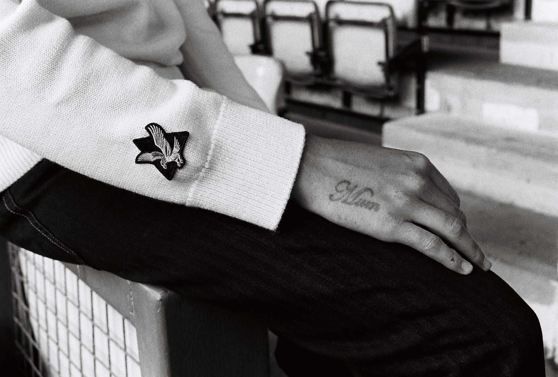 B/W, arm detail, Lad in Neal Heard Lyle and Scott