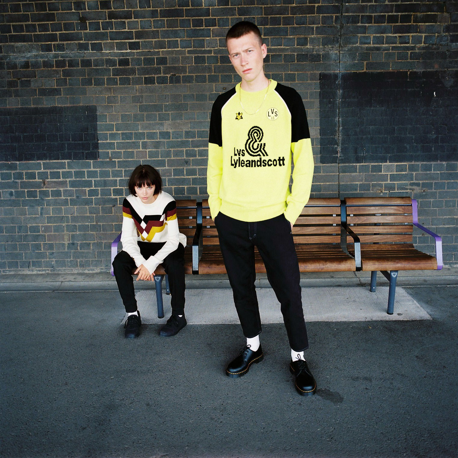 Lad and girl in train platform by lifestyle photographer Tim Cole