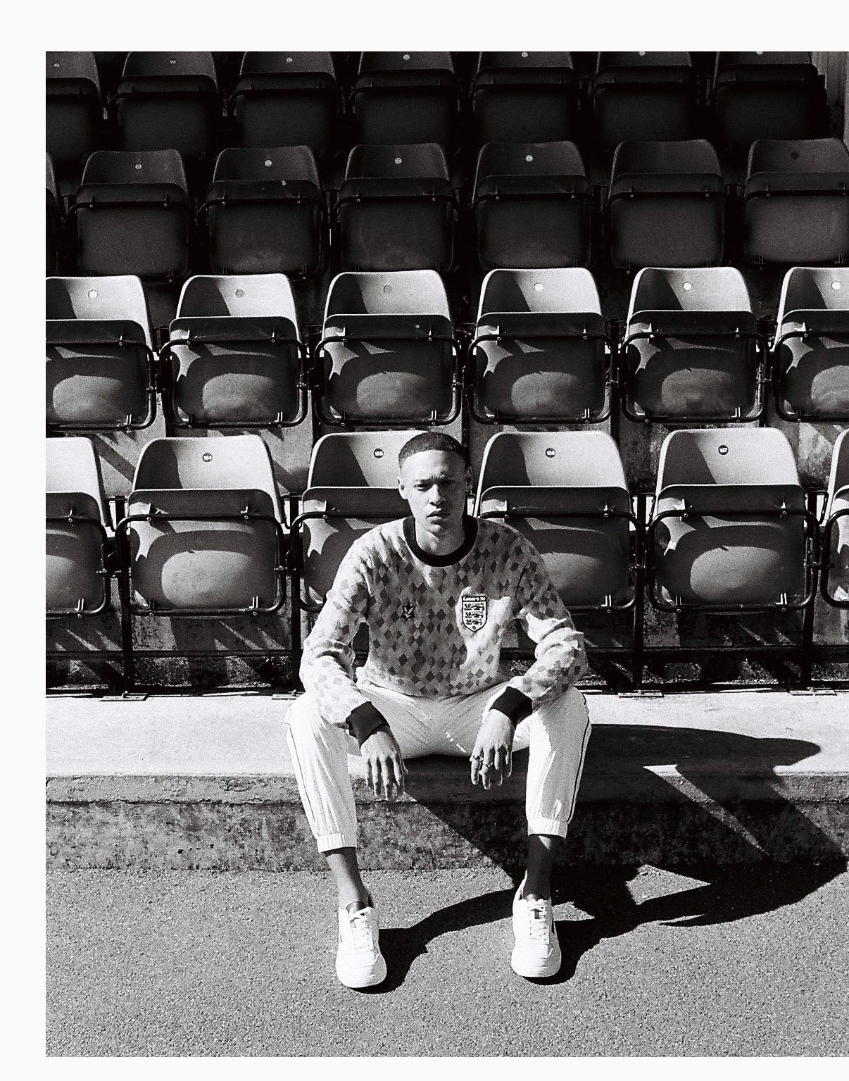 Lad in Neal on step of  stadium by lifestyle photographer Tim Cole