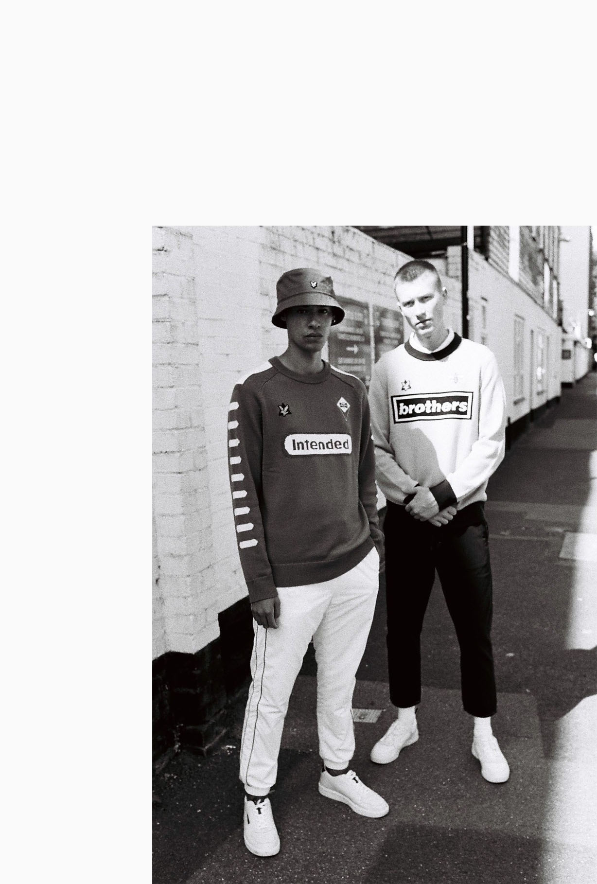B/W, 2 Lads outside  ground by lifestyle photographer Tim Cole
