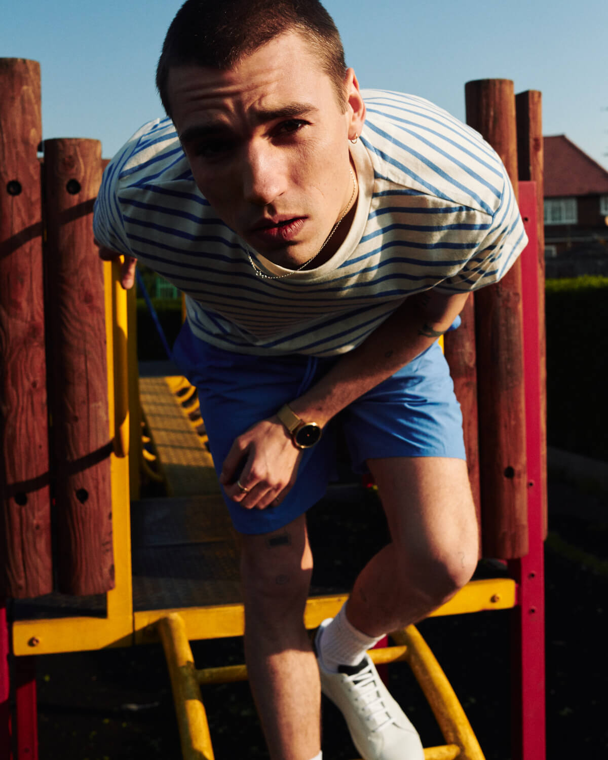 Lyle and Scott lad in park  by lifestyle photographer Tim Cole