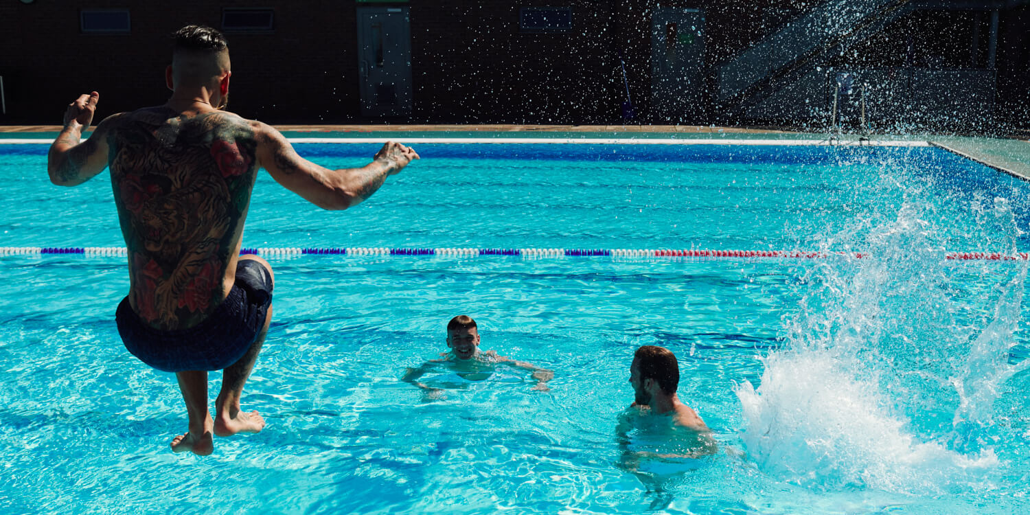 Three lads jumping in  by  lifestyle photographer Tim Cole