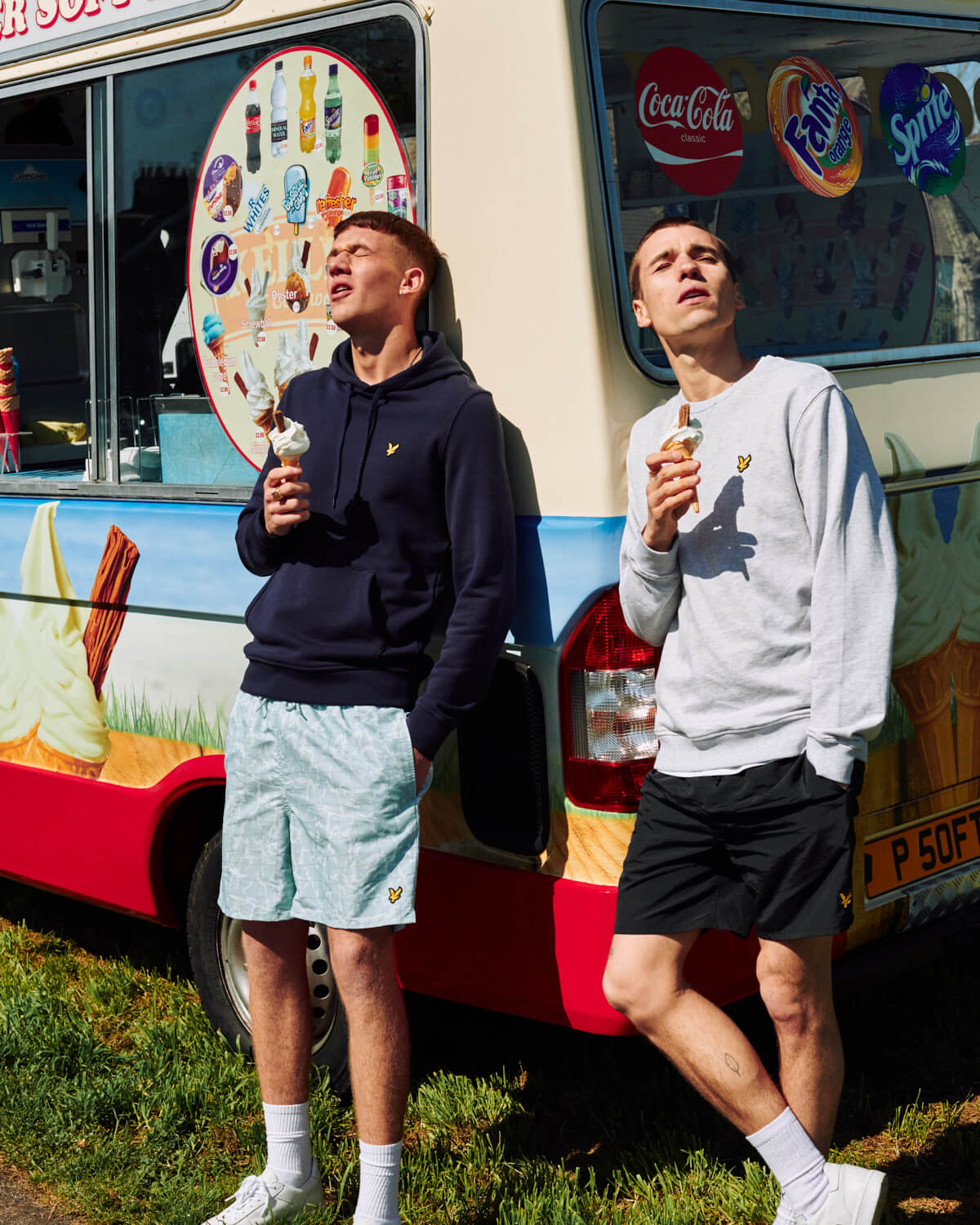 Two ladst eat ice cream by  van by lifestyle photographer Tim Cole