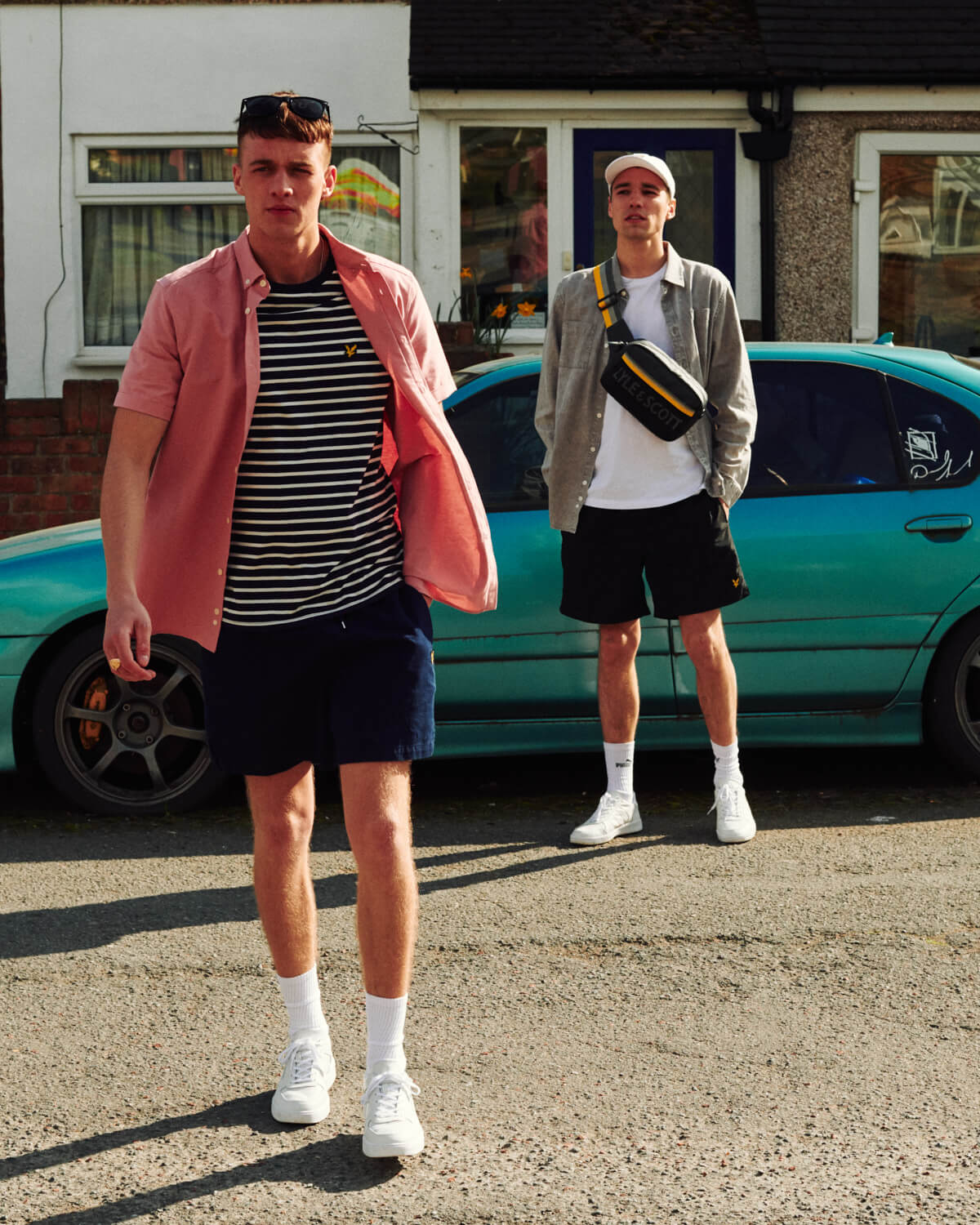 Two lads stand in road, by lifestyle photographer Tim Cole