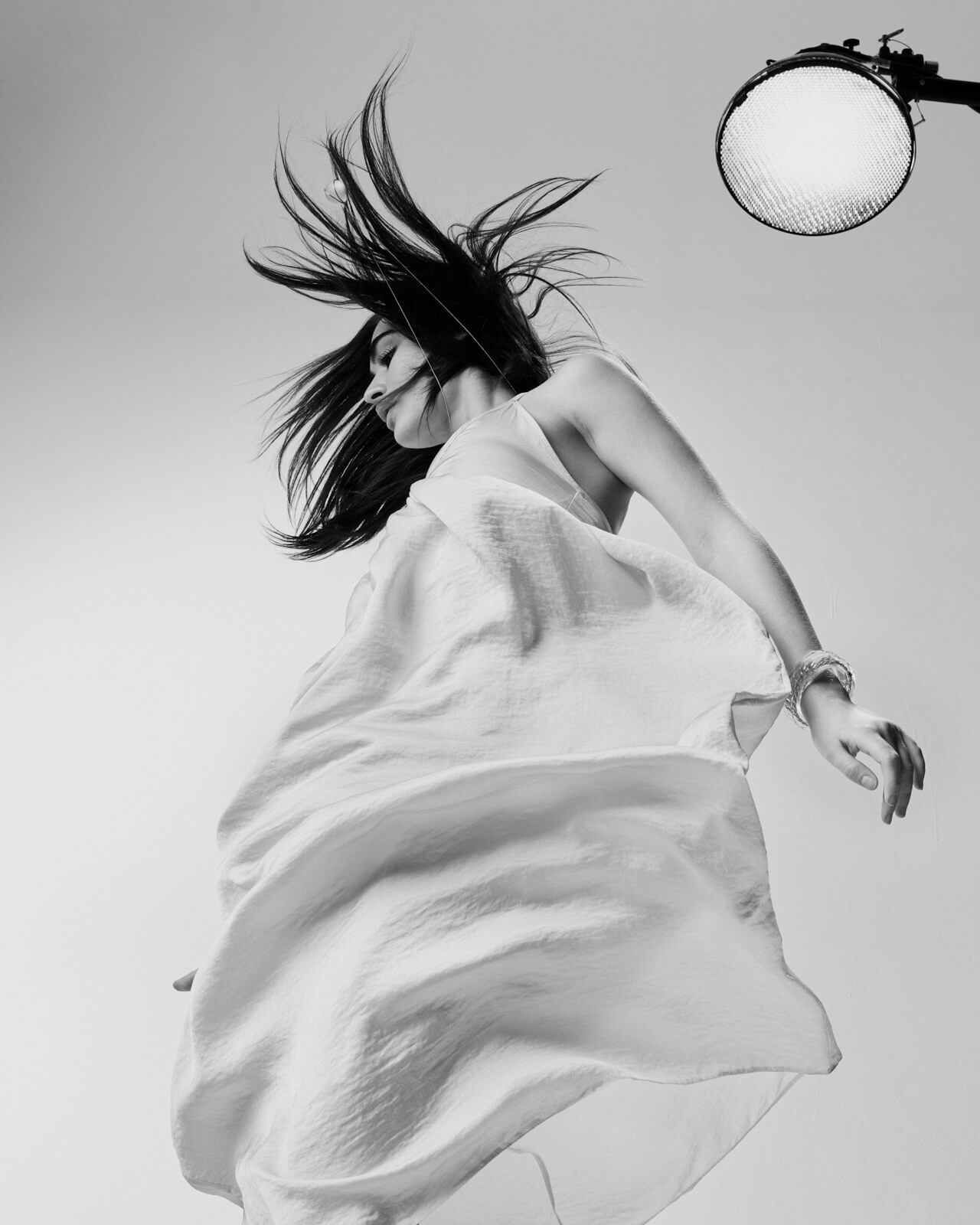 Young woman, white dress, by lifestyle photographer Tim Cole