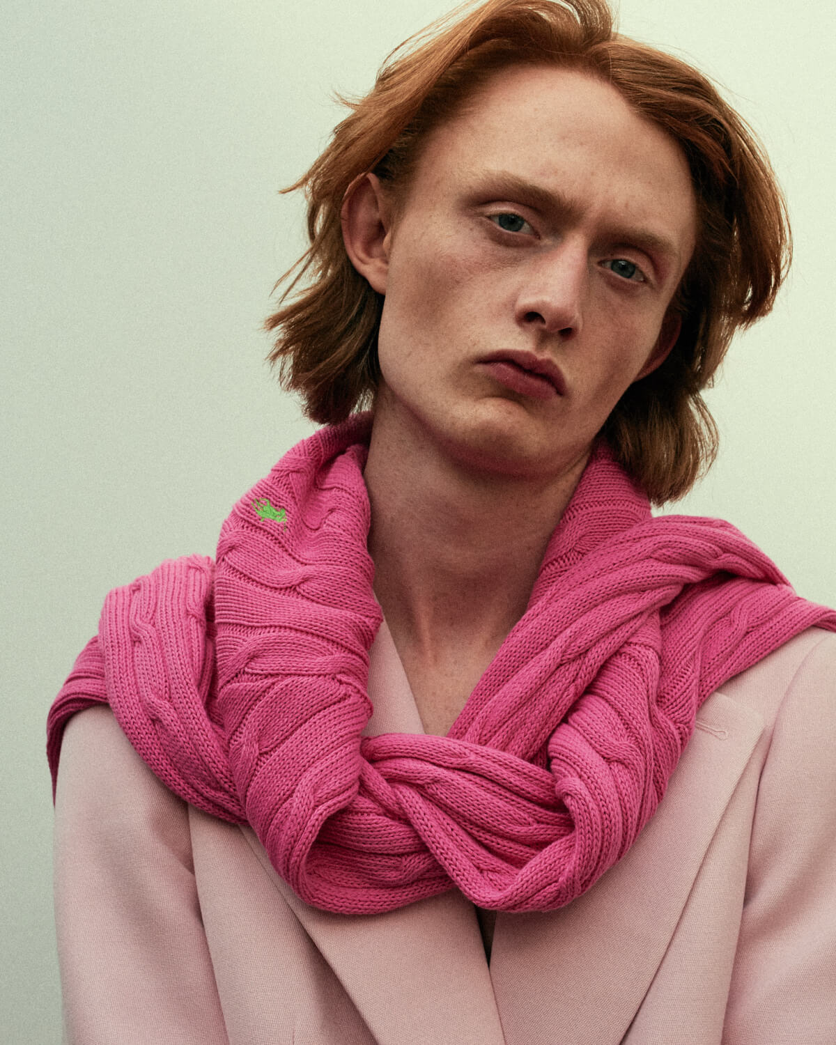 Lad, pink jacket, by lifestyle photographer Tim Cole