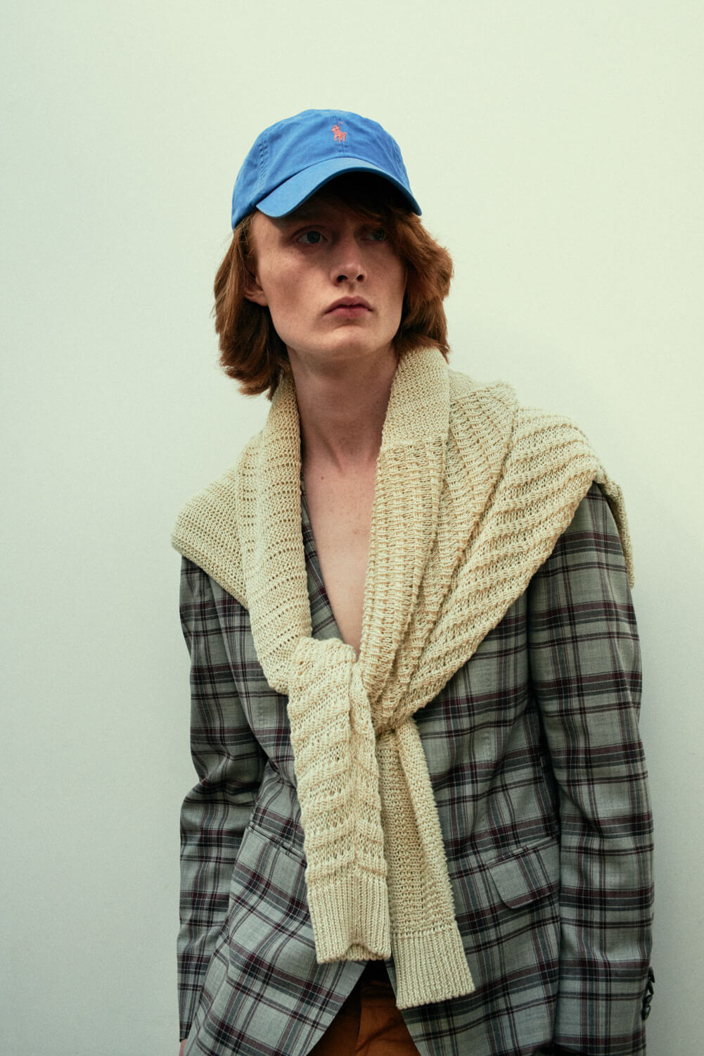 Lad checked jacket blue cap by lifestyle photographer Tim Cole