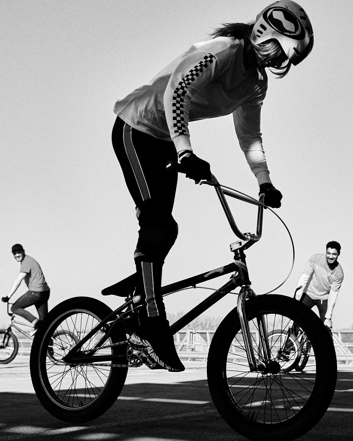 B/W, Gen Z girl silhouette, BMX clothes, rides stunt street bike by lifestyle photographer Tim Cole