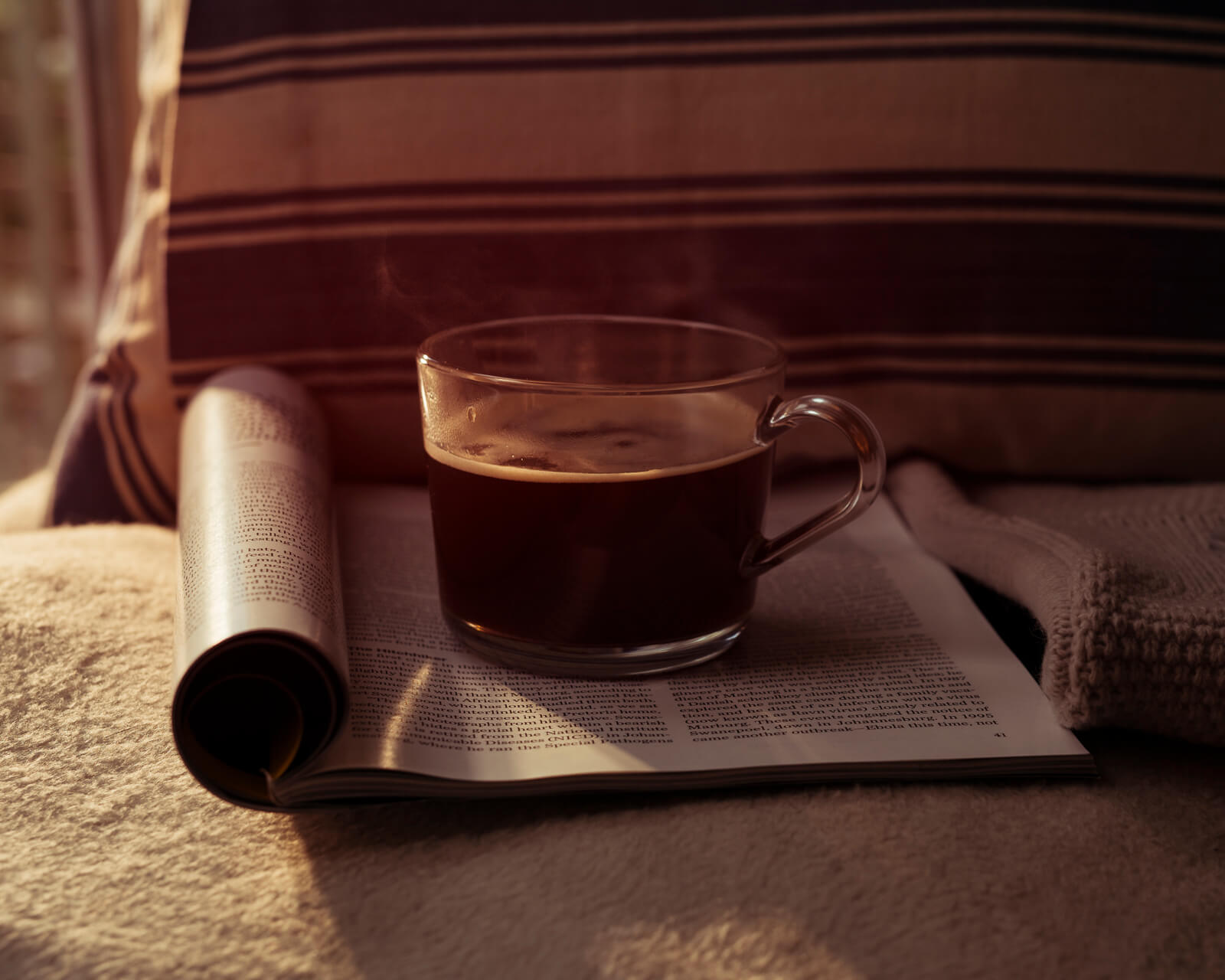 Hot  coffee sits on a magazine  by lifestyle photographer Tim Cole