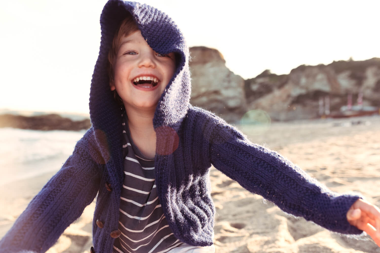 Lifestyle photographer Tim Cole shoots boy in blue hooded jumper