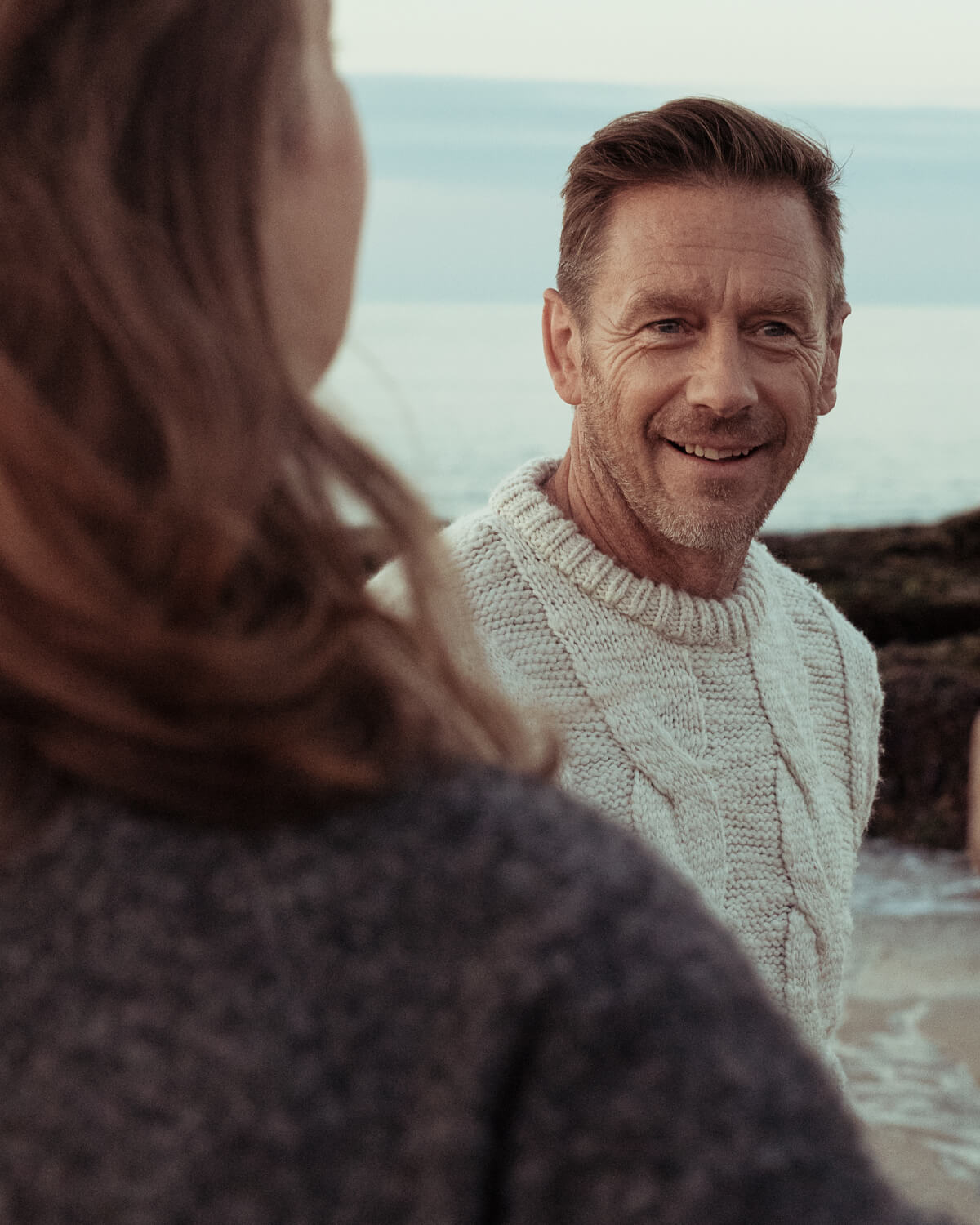 man in knitwear  by the sea by lifestyle photographer Tim Cole