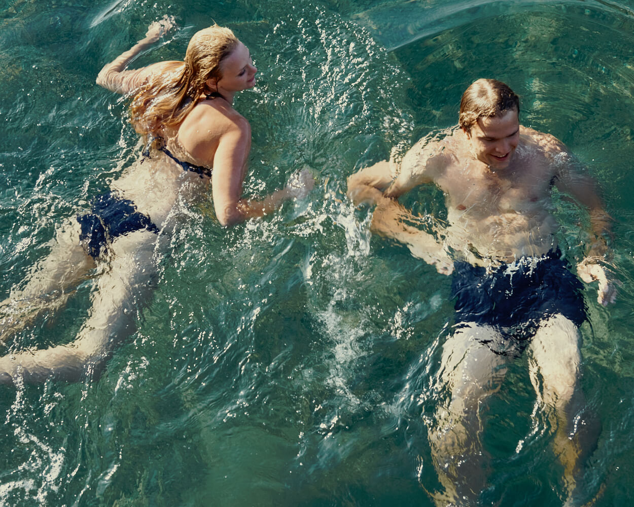 man and woman, swim by lifestyle photographer Tim Cole