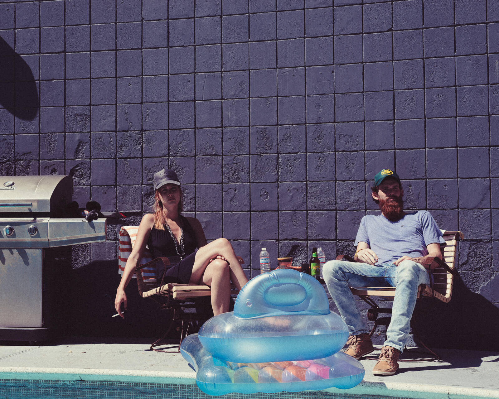 Hipster couple on chairs by lifestyle photographer Tim Cole