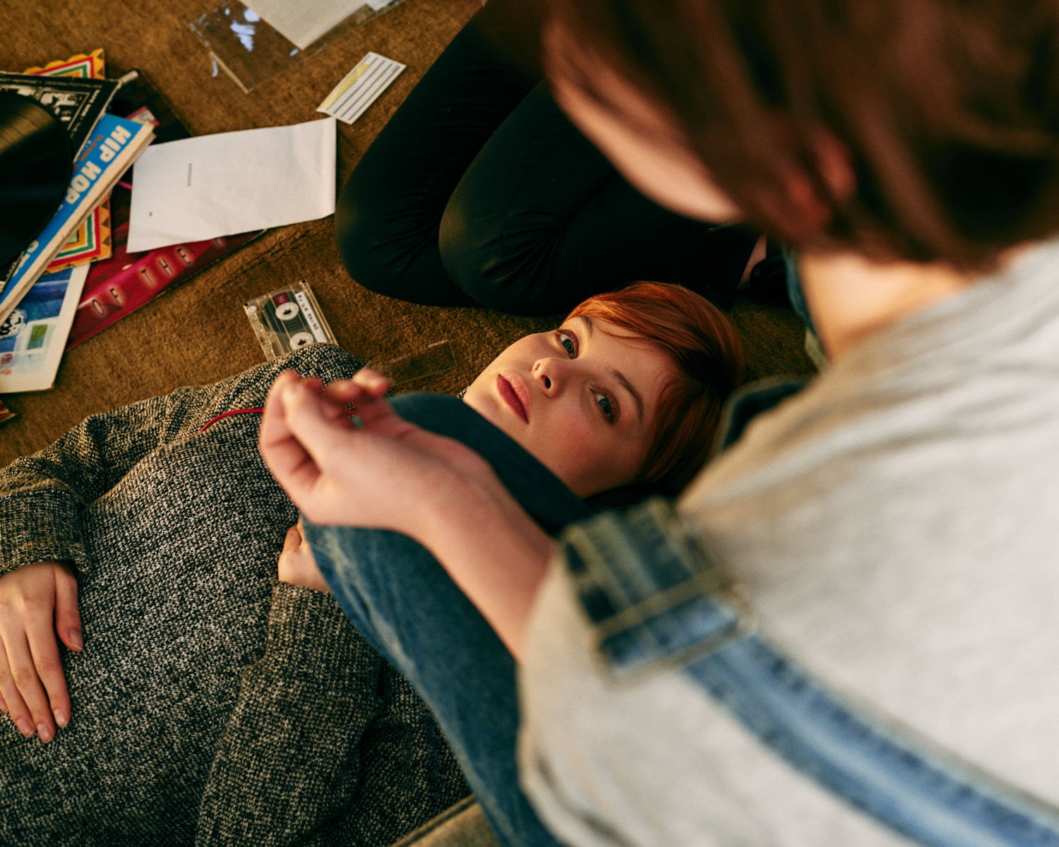 Girl, messy lounge floor by lifestyle photographer Tim Cole