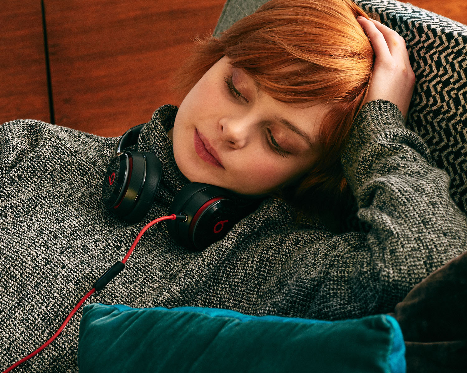 On sofa, 'Beats by Dre'  by lifestyle photographer Tim Cole