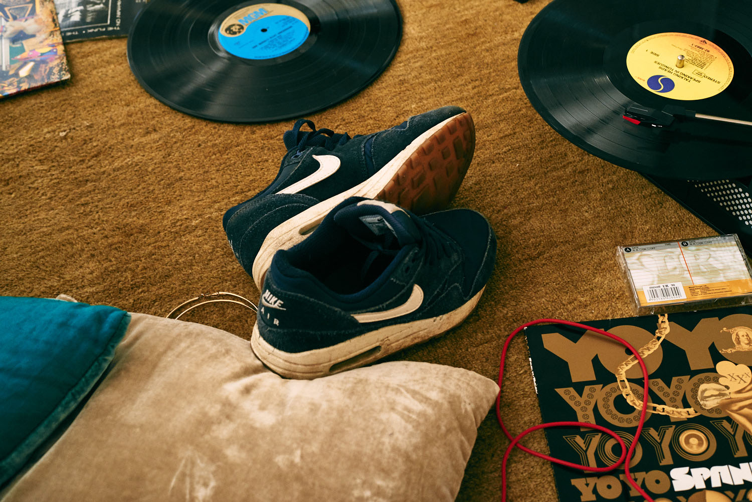 Blue Nike trainers,  by lifestyle photographer Tim Cole