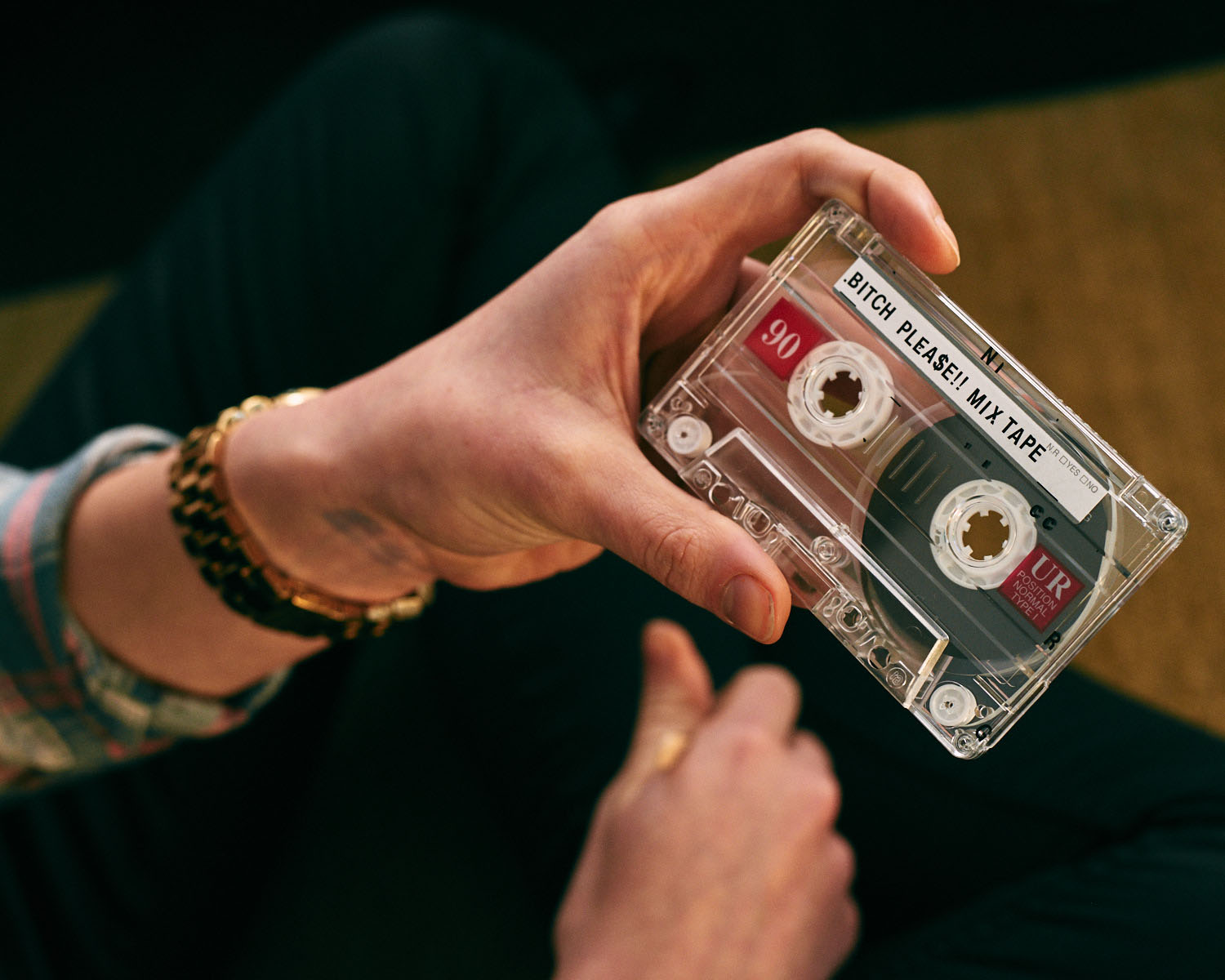 Hand/cassette tape, by lifestyle photographer Tim Cole