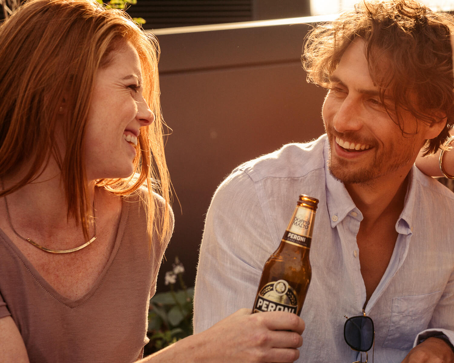 laugh drinking Peroni by lifestyle photographer Tim Cole