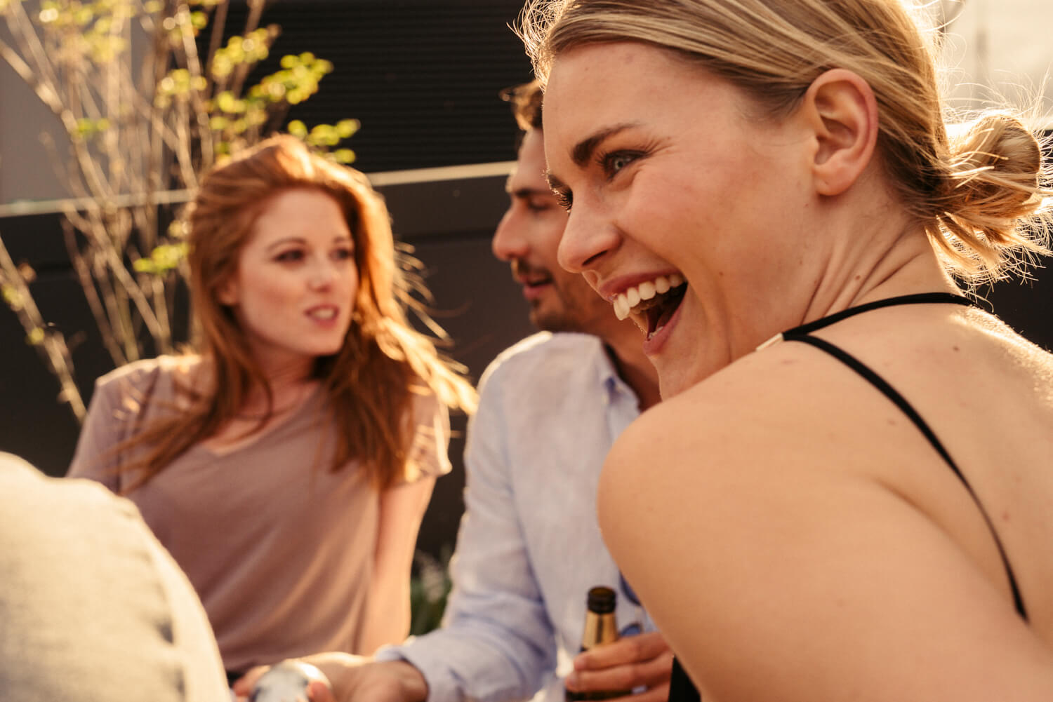 Friends drink outside, by lifestyle photographer Tim Cole
