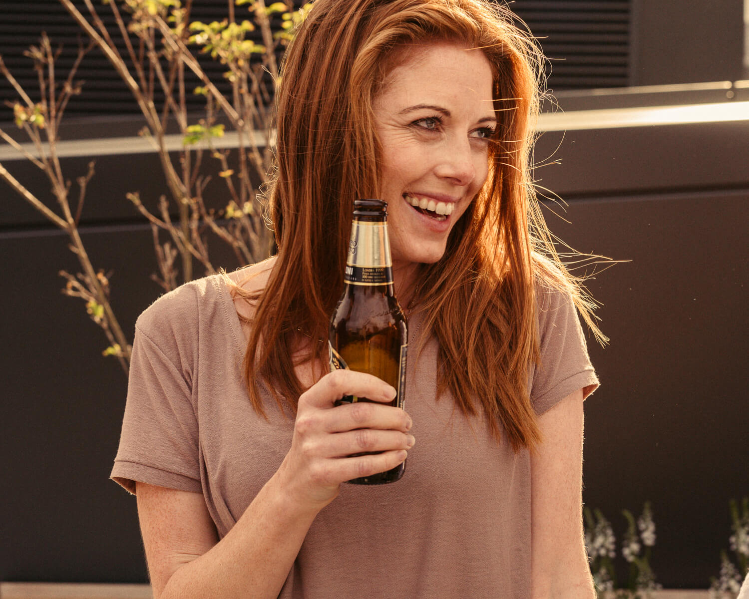 Red haired woman, laughing by lifestyle photographer Tim Cole