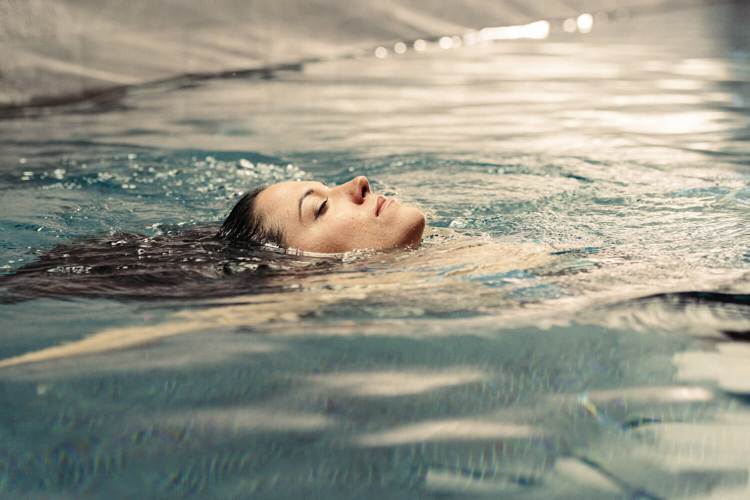 face above water, by lifestyle photographer Tim Cole
