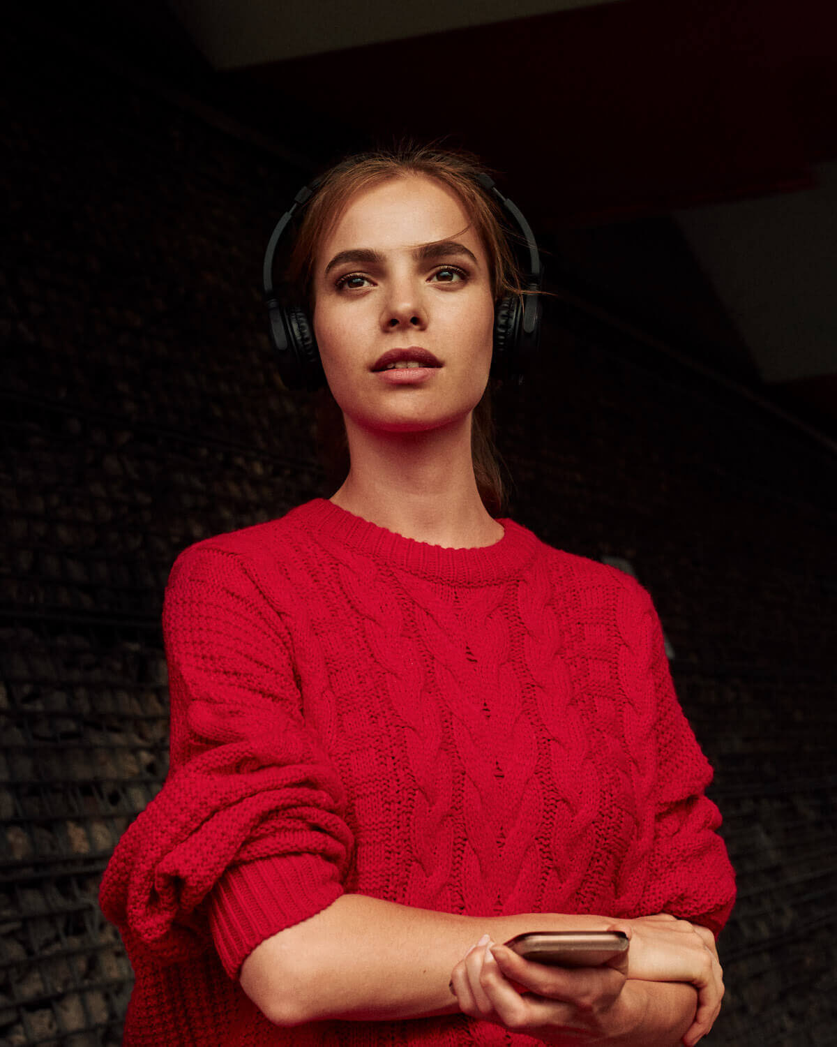 Girl, jumper, with headphones, portrait photographer Tim Cole