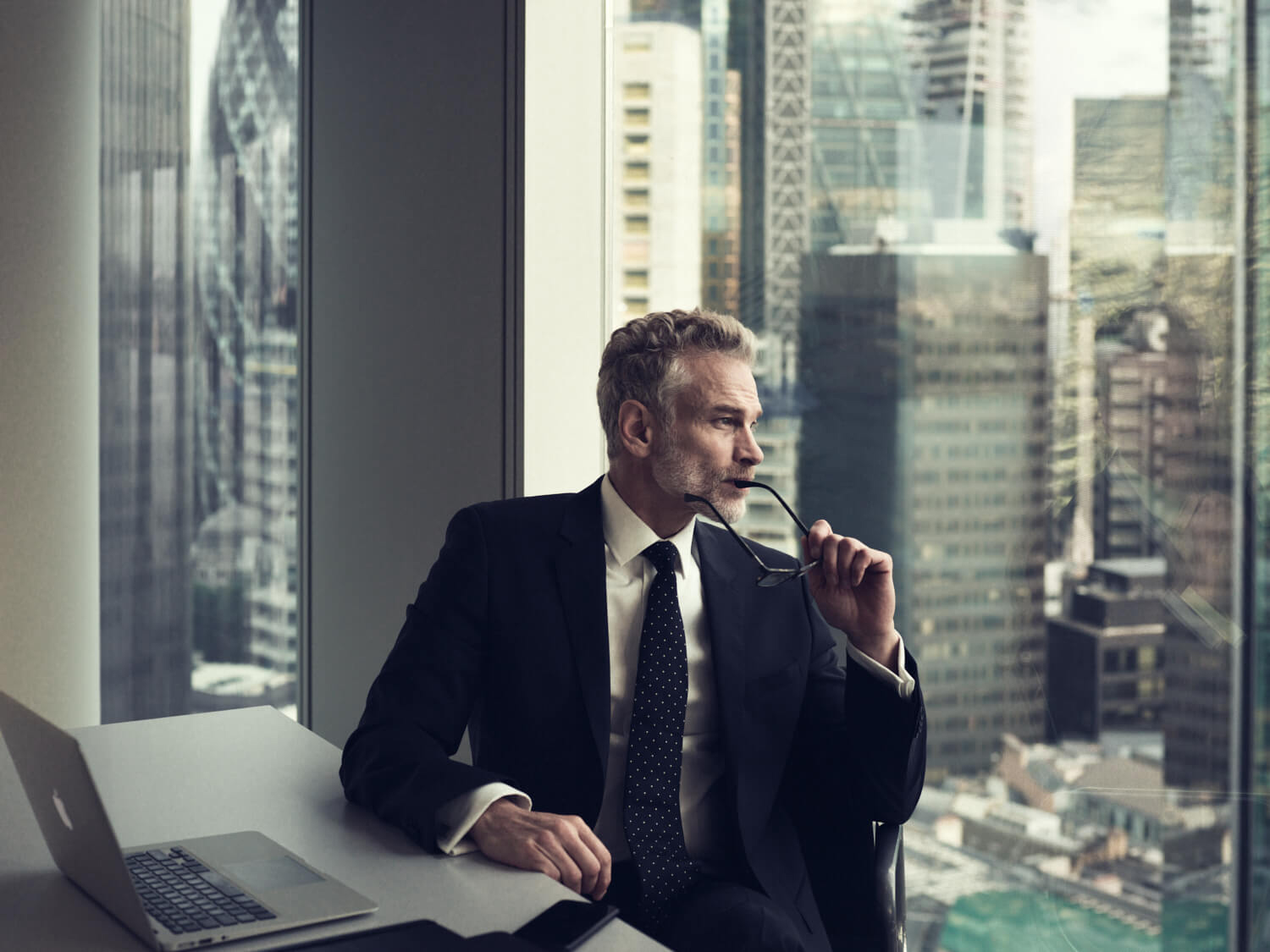 Businessman at desk, by lifestyle photographer Tim Cole
