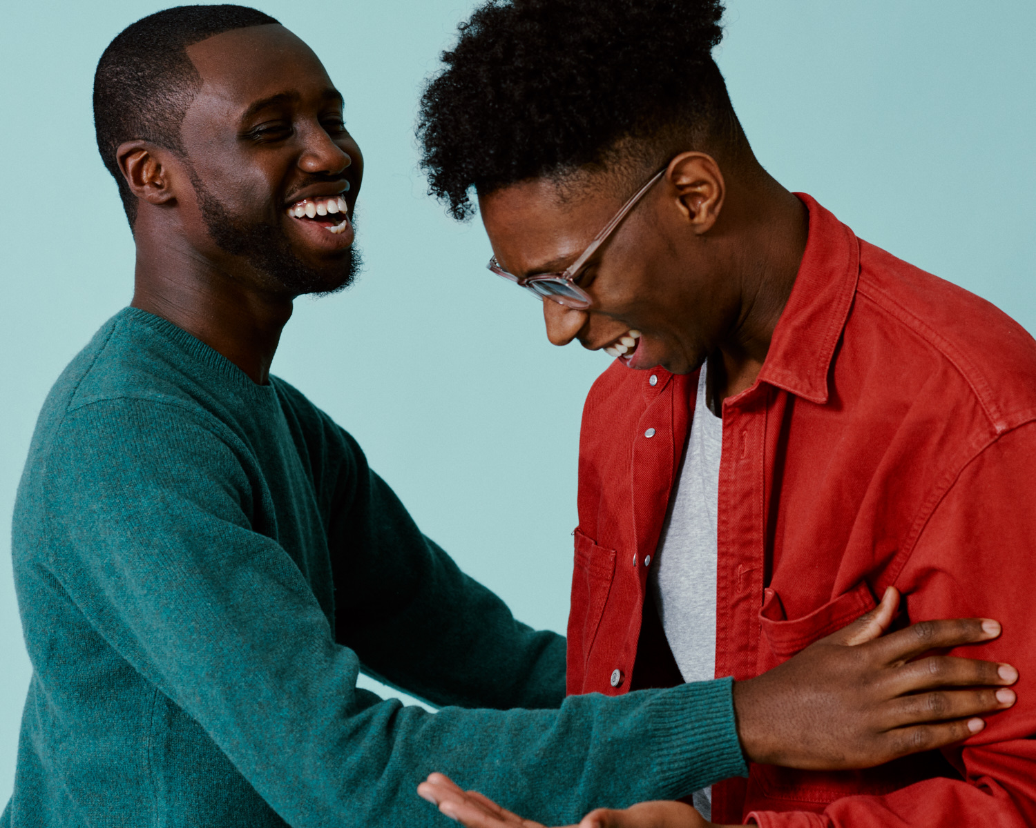 Two Amos Bursary  men hug and laugh, by portrait photographer