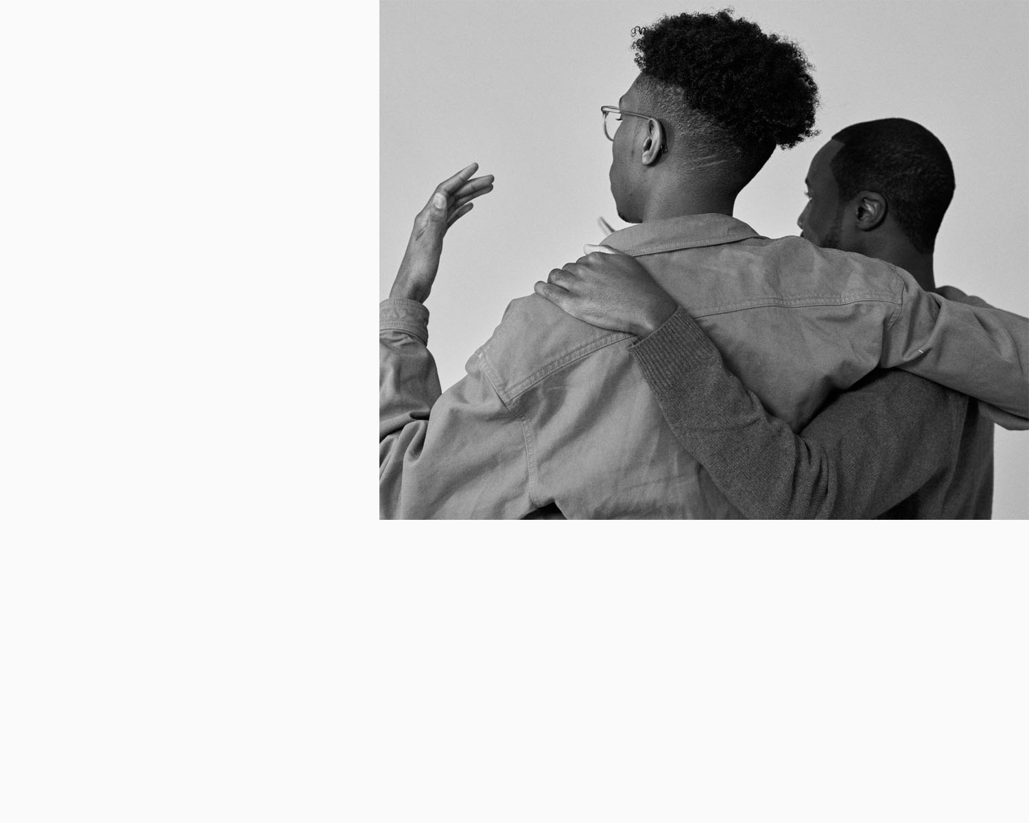 Amos Bursary men hold each other, by portrait photographer
